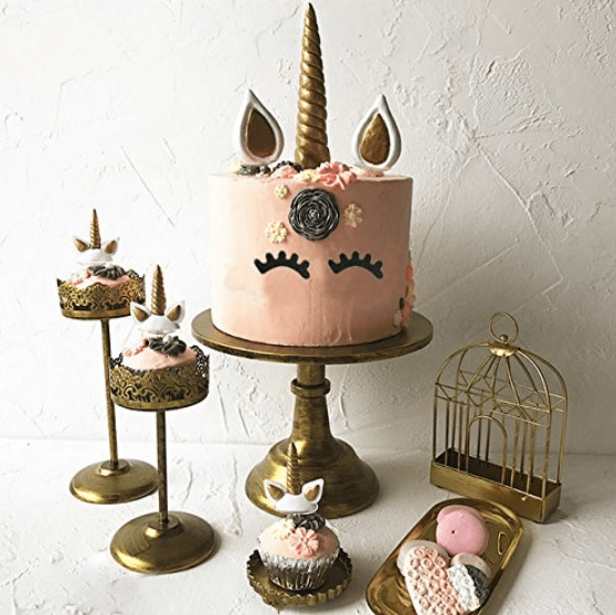 Unicorn birthday party cake. Pink and gold birthday party ideas.