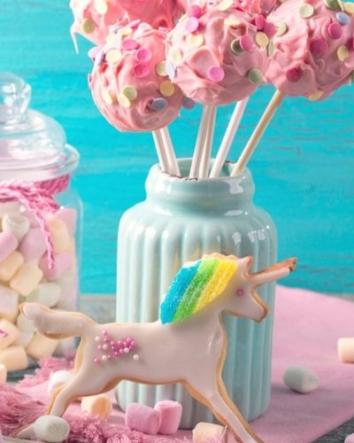 Unicorn themed birthday party ideas for fun and cute birthday cake, decorations. goodie bags, games and activities.