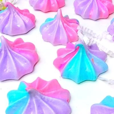 Unicorn themed birthday party ideas. Unicorn poop cookies. Purple blue and pink.
