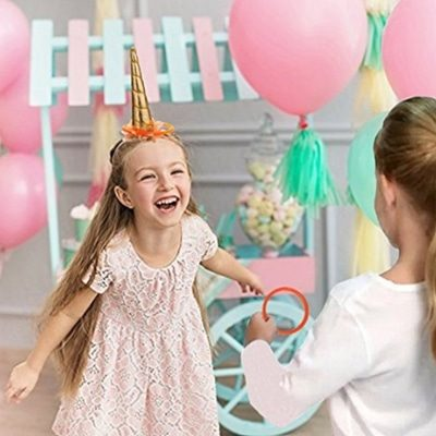 What a fun unicorn themed birthday party activity for kids. A unicorn ring toss game!