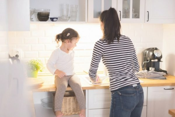 woman cleaning with daughter. family clean activity.