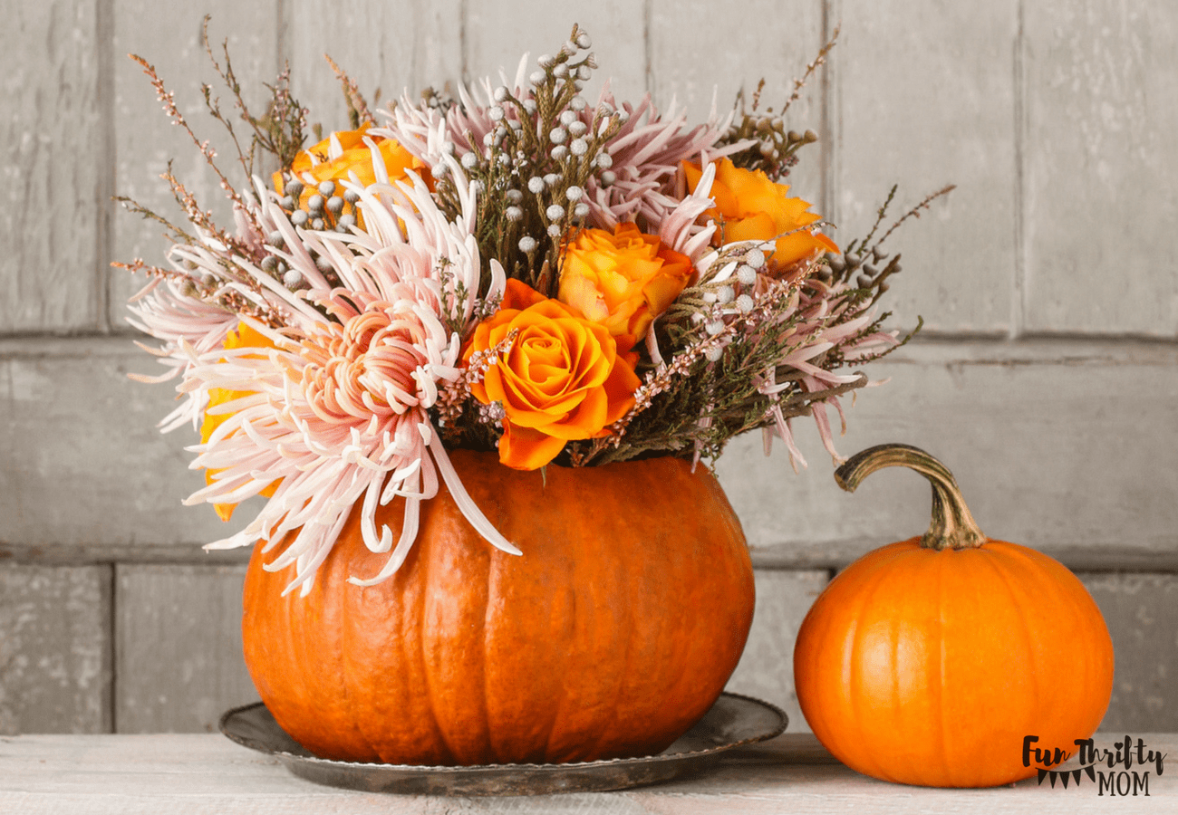 Gorgeous fall decor. Pumpkin with flowers as a centerpiece for thanksgiving.